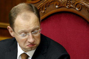 epa01514394 Speaker of Ukrainian Parliament Arseniy Yatsenyuk grimaces during a parliament session in Kiev, 09 October 2008. Ukrainian President Viktor Yushchenko dissolved parliament in a speech broadcast late 08 October and called for fresh elections. Following the collapse of the pro-Western coalition of Yushchenko?s party and Prime Minister Yulia Tymoshenko?s bloc, it is hoped that fresh elections will offer a way out of the current political impasse. EPA/SERGEY DOLZHENKO""